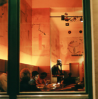 People in a cafe in the evening, Berlin, Germany
