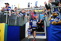 Matt Banahan of Bath Rugby leaves the field with his son after the match. Aviva Premiership match, between Bath Rugby and Newcastle Falcons on September 10, 2016 at the Recreation Ground in Bath, England. Photo by: Patrick Khachfe / Onside Images