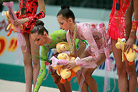 """(L-R) Mariya Mateva of Bulgaria and Daria Dmitrieva of Russia pick up their gifts during the event finals awards ceremony at 2008 World Cup Kiev, """"Deriugina Cup"""" in Kiev, Ukraine on March 23, 2008."""