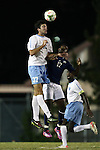 28 October 2014: North Carolina's Walker Hume (37) and Georgia Southern's Emmanuel Raji (17). The University of North Carolina Tar Heels hosted the Georgia Southern University Eagles at Fetzer Field in Chapel Hill, NC in a 2014 NCAA Division I Men's Soccer match. North Carolina won the game 6-2.