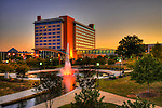 Embassy Suites Hotel with Thrasher Memorial Fountain in Huntsville, AL lit pink for Breast Cancer Awareness Month.  Bob Gathany photo.