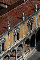 High angle view of the Loggia del Consiglio, 1476, Piazza dei Signori, Verona, Italy, seen from the Lamberti Tower. Statues of illustrious citizens of Verona crown the roof of the Loggia del Consiglio, home of the City Council, renovated in the 1870s. Picture by Manuel Cohen.