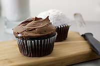 Chocolate and White Cupcakes with Glass of Milk