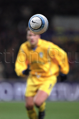Detail of a football in the air with an out of focus player in the background, PSV Eindhoven 0 v Leeds United 0, UEFA Cup, Philips Stadium, 020221. Photo: Neil Tingle/Action Plus...2002.association football.soccer ball.detail.sports equipment.  ident.illustration