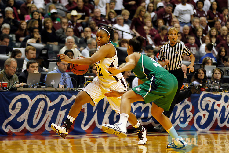05 APR 2011:  Adrienne Pratcher (32) of Texas A&M pushes the ball up the court as she is guarded by Skylar Diggins (right) of Notre Dame  during the Division I Women's Basketball Championship held at Conseco Field in Indianapolis, IN.  The Aggies defeated the Irish by a score of 76-70 to take home the National Championship.  Jamie Schwaberow/NCAA Photos
