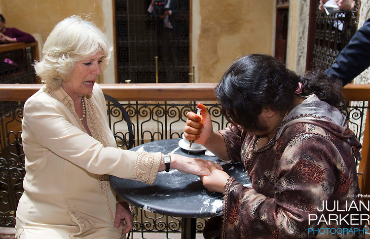 **POOL PHOTO** Camilla, Duchess of Cornwall has a henna hand tattoo during a visit to The Cafe Clock in The Medina, in Fez.