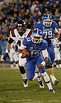 Kentucky Wildcats quarterback Jalen Whitlow (13) runs the ball during the first half of the UK Football game v. Samford at Commonwealth Stadium in Lexington, Ky., on Saturday, November 17, 2012. Photo by Genevieve Adams | Staff