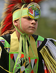A Native American boy dances at the 8th Annual Red Wing American Indian PowWow at Red Wing Park in Virginia Beach, Virginia.