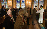 BLESSING THE THROATS SERVICE CEREMONY SAINT ETHELDREDA'S CHURCH LONDON STOCK PHOTOGRAPHY ENGLAND UK