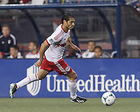 New York Red Bulls forward Fabian Espindola (9) on the attack. In a Major League Soccer (MLS) match, the New England Revolution (blue) tied New York Red Bulls (white), 1-1, at Gillette Stadium on May 11, 2013.