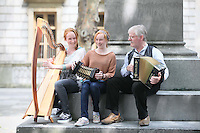 NO REPRO FEE. 14/7/2011. To commemorate the 60th anniversary of Comhaltas Ceoltóirí Éireann 15 year old twins Alva and Niamh Casey joined 67 year old Eddy O'Kelly in Kildare St Dublin for an impromptu music session. Comhaltas is the largest group involved in the preservation and promotion of Irish traditional music. Reaching 60 does not mean the organisation plans to slow down anytime soon, as the efforts of Comhaltas continue with increasing zeal as the movement continues to grow and diversify. The organization has a jam packed summer schedule to commemorate this milestone. Visit www.comhaltas.ie for more information and upcoming events in your area. Picture James Horan/Collins