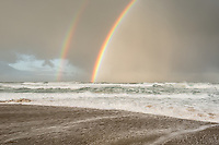 Dawn on beach at Kohaihai near Karamea with rainbow, West Coast, Buller Region, Kahurangi National Park, New Zealand