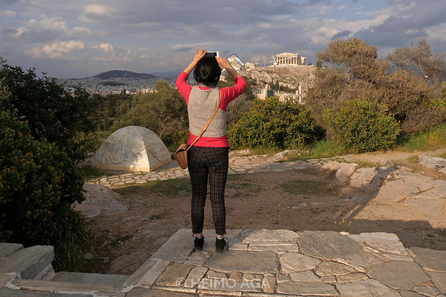 Athens, Greece. Opening days of documenta14.<br /> Philopappos Hill. Marble tent by Rebecca Belmore with view of the Acropolis.