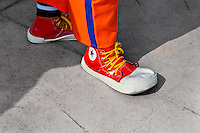 A clown wears oversized red Converse sneakers during the Clown Congress in San Salvador, El Salvador, 18 May 2011. The clown performance is considered a regular job in most of Latin American countries. Clowns may work individually or in groups, often performing advertisement like acts in large open-to-street shops or they take part in private shows, like children birthdays, family events etc. There are many clown conventions all over Latin America where clowns gather and exchange their experiences offering workshops of the comic acting or the art of make-up. For some of them, being clown is a serious lifetime profession.