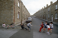 August 1981. Newcastle area, England. During the summer the kids have no school or vacation plans, so they play in the streets.