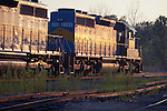 Waiting for clearance across the BNSF at Savanna, IL, a pair of DM&E/IC&E/Canadian Pacific SD40-2 locomotives reflect the late afternoon sun.