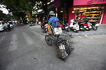 A bicycle deliveryman peddles along a street near the Old Quarter in Hanoi, Vietnam. Nov. 2, 2012.
