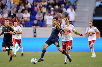 Landon Donovan (10) of the Los Angeles Galaxy is trailed by Carlos Mendes (44) of the New York Red Bulls. The Los Angeles Galaxy defeated the New York Red Bulls 1-0 during a Major League Soccer (MLS) match at Red Bull Arena in Harrison, NJ, on August 14, 2010.
