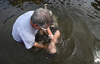 NWA MEDIA SAMANTHA BAKER @NWASAMANTHA<br /> Pastor Ron Carter baptizes Lisa Fabrizio Sunday, July 27, 2014, at Lake Avalon during Bella Vista Christian Church's baptizing event.