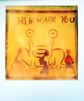 "Polaroid instant color picture of Austin's famous ""Hi How Are You"" Mural as University of Texas students walk to class - Stock Image."