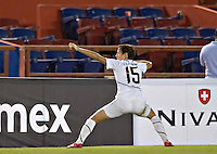 Action photo of Megan Rapinoe of USA celebrating a score at the 2010 CONCACAF Women's World Cup Qualifying tournament held at Estadio Quintana Roo in Cancun, Mexico.
