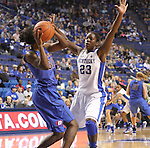 Junior forward, Samarie Walker, defends the ball against DePaul's Jasmine Penny. The University of Kentucky Women's Basketball team hosted DePaul University Friday, Dec 07, 2012 at Rupp Arena in Lexington. Photo by Kirsten Holliday | Staff