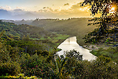 A misty view of Kilauea River and Valley at sunset, Kaua'i.