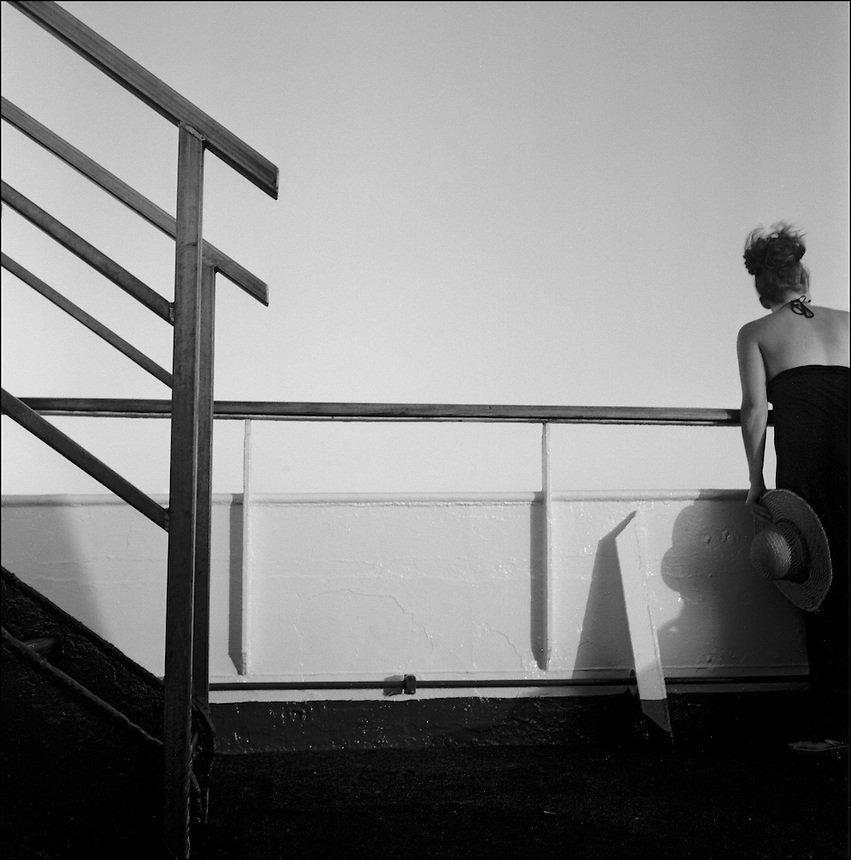 Woman with hat<br /> En route to Bahamas.<br /> From &quot;The other wind&quot; series