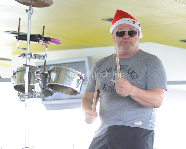 Michael Chiklis seen playing the bongos at a local Miami Beach bar  in Miami, Florida. January 1, 2011. © MediaPunch Inc. / MPI04