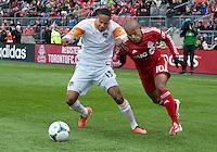 20 April 2013:Toronto FC forward Robert Earnshaw #10 and Houston Dynamo midfielder Ricardo Clark #13 in action during the first half in an MLS game between the Houston Dynamo and Toronto FC at BMO Field in Toronto, Ontario Canada...
