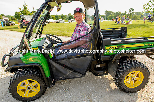 """Pink Tractor Foundation held its fifth annual fundraiser in support of fighting cancer in St. Marys at the Brommel family farm Saturday, June 11. Tom Brommel helped shuttle his friends, neighbor and other friendly visitors to the celebration area. He was known a """"Uber Tom"""" for the day."""