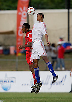 Adrian Diz (4) of Cuba goes up for a header against Alfredo Stephens (19) of Panama during the group stage of the CONCACAF Men's Under 17 Championship at Jarrett Park in Montego Bay, Jamaica. Panama tied Cuba, 0-0.
