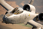 "An A-10 Thunderbolt II, also know as the ""Warthog"", inches up to the cargo ramp of a C-130J Hercules of the Rhode Island Air National Guard during the California International Airshow in Salinas."
