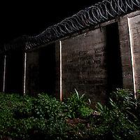 A razor wire topped wall surrounding Pademba Central Prison. It holds around 1400 inmates.