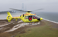 Coming in to land on a small island near the Storeb&aelig;lt bridge. Denmarks first  air ambulance serivce, operated by Norwegian Air Ambulance. The crew is pilot Jan Nielsen, HEMS paramedic Lars Greve-Wilms and doctor Rikke Helene Rasmussen. <br /> <br /> The crew operate an Airbus EC-135 out of the Ringsted base, one of three bases in Denmark.