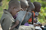 A girl writes the alphabet on a chalkboard at the Loreto Primary School in Rumbek, South Sudan. The school is run by the Institute for the Blessed Virgin Mary--the Loreto Sisters--of Ireland.