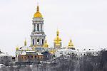 Travel stock photo of Kievo-pecherskaya lavra - Kiev pechersk lavra - Cave monastery on a snow covered hill Kiev Ukraine Eastern Europe Horizontal view from the left bank of the Dnieper river November 2007