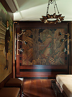 The focus of the guest bedroom is a decorative wall panel on a canvas, taken from an Art Deco palace in Egypt