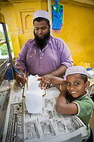The owner of a nasi kandar food stall  and his son in George Town, Penang.