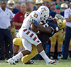Aug. 31, 2013; Linebacker Prince Shembo (55) brings down Temple Owls halfback Zaire Williams (23).<br /> <br /> Photo by Matt Cashore
