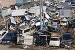 Photo shows cars and trucks that were swept inland by the tsunami that followed the March 11 magnitude 9 quake in Sendai City, Miyagi Prefecture on 13 March, 2011.  Photographer: Robert Gilhooly