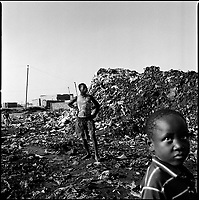 Luanda, Angola, May, 20, 2006.Cazenga slums; children playing in garbage and cholera infected waters. Between February and June 2006, more than 30000 people were infected with cholera in Angola's worse outbreak ever; more than 1300 died.