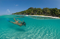 Snorkeler Zan VanBrunschot explores the sunlit shallows off Radhanagar Beach, a.k.a. Beach #7, Havelock Island, Andaman Islands, Andaman Sea, India