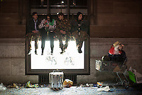 Young people sit on a window ledge in the old town of Basel during celebrations surrounding Fasnacht, the Carnival of Basel in Switzerland. Feb. 24, 2015.
