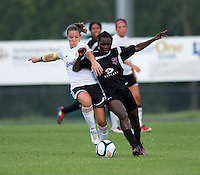Odishika Chukwuji (2) of the Virginia Beach Piranhas fights for the ball with Missy Wycinsky (2) of the Fredericksburg Impact during the game at the University of Mary Washington Battleground Stadium in Fredericksburg, VA.   The Virginia Beach Piranhas defeated the Fredericksburg Impact, 2-0, in a weather shortened game.