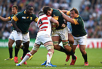 Lodewyk De Jager of South Africa takes on the Japan defence. Rugby World Cup Pool B match between South Africa and Japan on September 19, 2015 at the Brighton Community Stadium in Brighton, England. Photo by: Patrick Khachfe / Onside Images