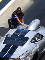 Jun 18, 2016; Bristol, TN, USA; Crew member with NHRA pro mod driver Bob Rahaim during qualifying for the Thunder Valley Nationals at Bristol Dragway. Mandatory Credit: Mark J. Rebilas-USA TODAY Sports