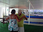 South America, Brazil. Amazon River. Dancing on the Iberostar Grand Amazon deck.