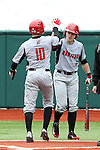 21 February 2015: Hartford's Chris DelDebbio (10) celebrates his run with TJ Ward (3). The Iona College Gaels played the University of Hartford Hawks in an NCAA Division I Men's baseball game at Jack Coombs Field in Durham, North Carolina as part of the Duke Baseball Classic. Hartford won the game 12-1.