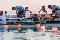 On Memorial Day, volunteers on a boat place lanterns in the ocean at the 15th Annual Lantern Floating Ceremony at Ala Moana Beach Park, Honolulu, O'ahu.